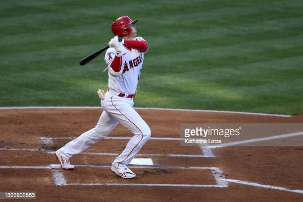 Shohei Ohtani of the Los Angeles Angels hits a home run in the first inning against the Kansas City Royals at Angel Stadium of Anaheim on June 08,...