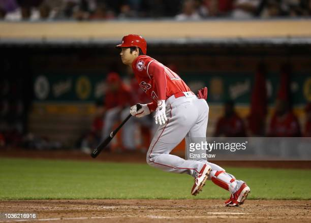 Shohei Ohtani of the Los Angeles Angels hits a single in the seventh inning against the Oakland Athletics at Oakland Alameda Coliseum on September 19...