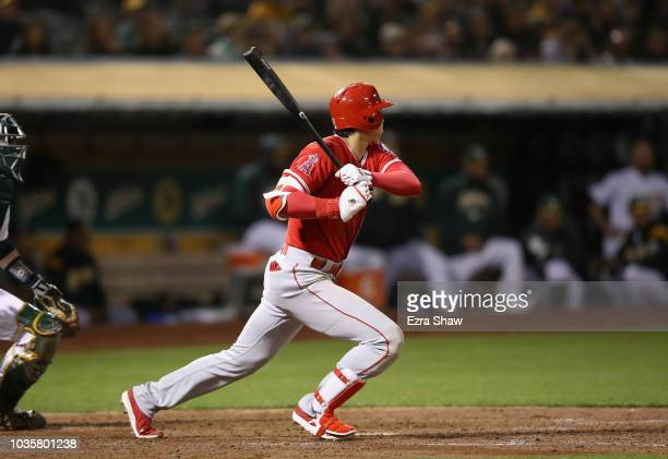 Shohei Ohtani of the Los Angeles Angels hits a single in the sixth inning against the Oakland Athletics at Oakland Alameda Coliseum on September 18...