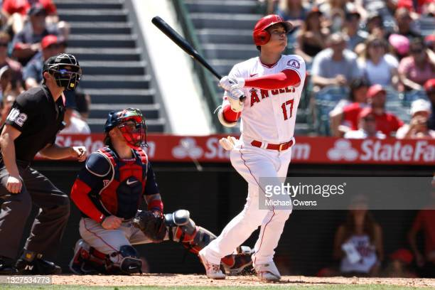 Shohei Ohtani of the Los Angeles Angels hits a solo home run against the Boston Red Sox during the fifth inning at Angel Stadium of Anaheim on July...