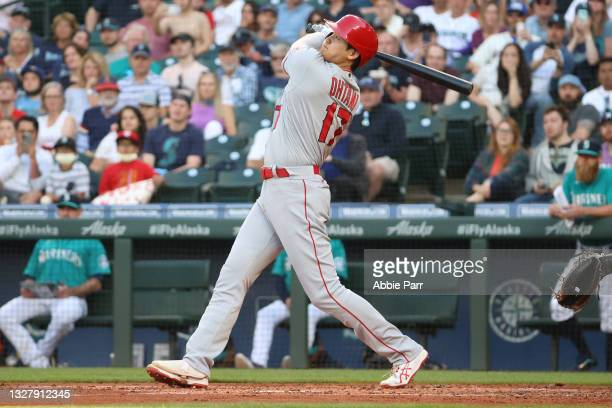 Shohei Ohtani of the Los Angeles Angels hits a solo home run during the third inning against the Seattle Mariners at T-Mobile Park on July 09, 2021...