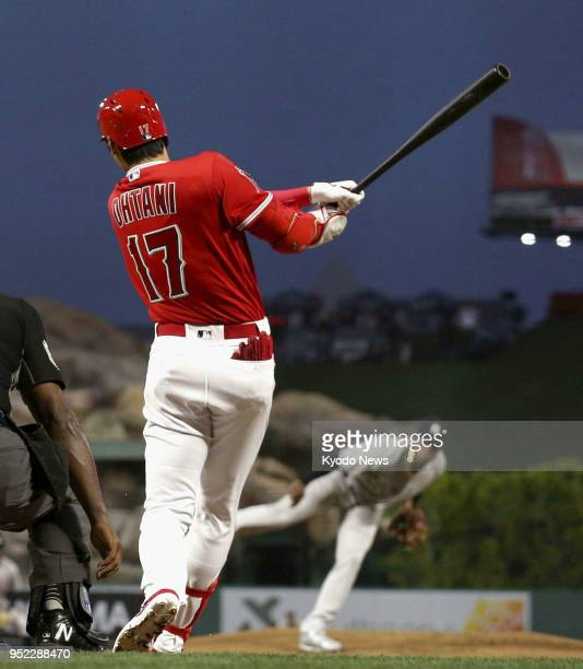 Shohei Ohtani of the Los Angeles Angels hits a solo home run his fourth of the season in the second inning of a game against the New York Yankees in...