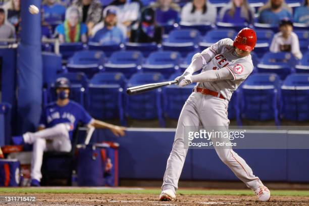 Shohei Ohtani of the Los Angeles Angels hits a solo home run to center field during the fifth inning against the Toronto Blue Jays at TD Ballpark on...
