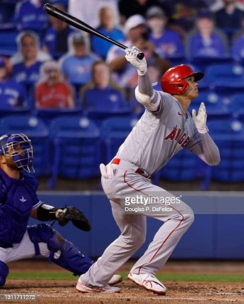 Shohei Ohtani of the Los Angeles Angels hits a three run rbi double during the second inning against the Toronto Blue Jays at TD Ballpark on April...