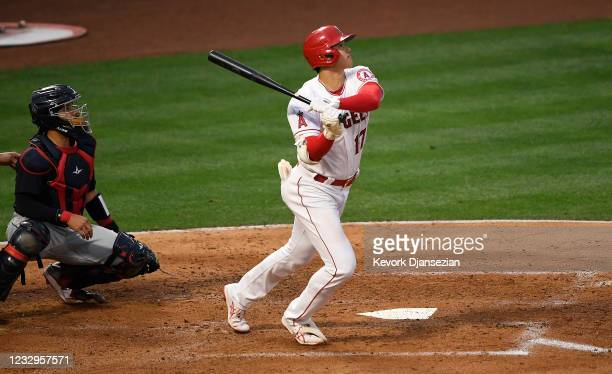 Shohei Ohtani of the Los Angeles Angels hits a three-run home run against pitcher Sam Hentges of the Cleveland Indians as catcher Rene Rivera looks...