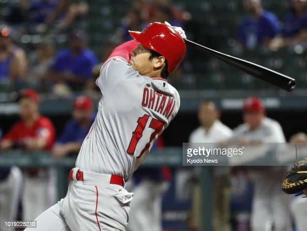 Shohei Ohtani of the Los Angeles Angels hits a threerun homer in the seventh inning of the team's 117 win over the Texas Rangers in Arlington Texas...