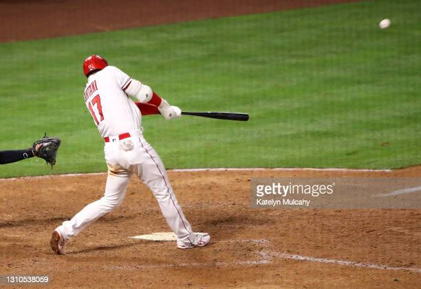 Shohei Ohtani of the Los Angeles Angels hits a two run home run against the Chicago White Sox during the ninth inning at Angel Stadium of Anaheim on...