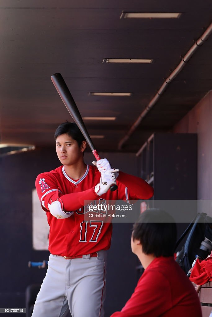 Shohei Ohtani #17 of the Los Angeles Angels in the dugout during the second inning of the spring training game against the San Diego Padres at Peoria Stadium on February 26, 2018 in Peoria, Arizona.
