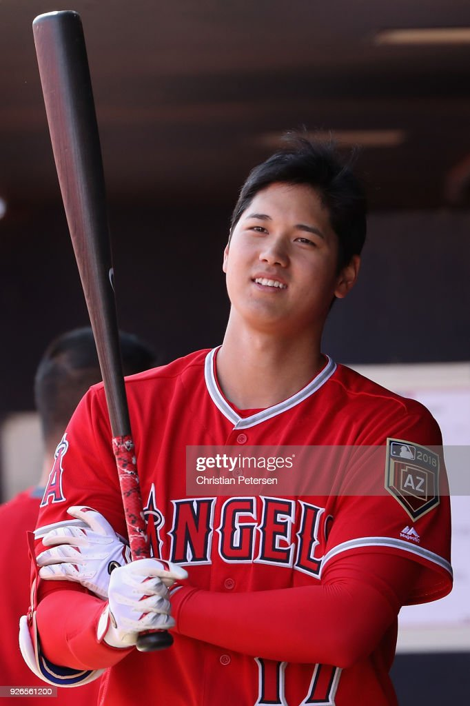 Shohei Ohtani #17 of the Los Angeles Angels in the dugout during the spring training game against the San Diego Padres at Peoria Stadium on February 26, 2018 in Peoria, Arizona.
