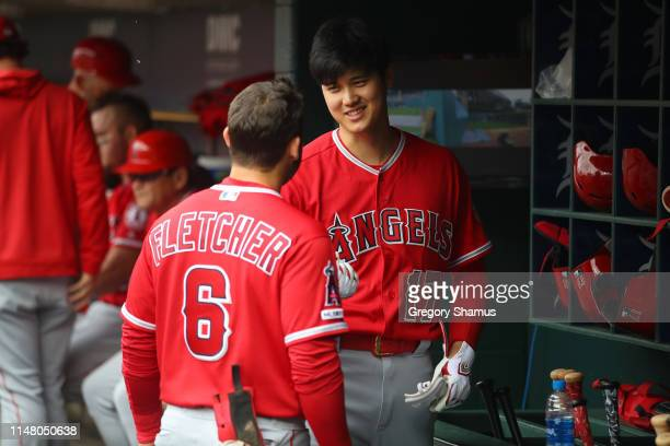 Shohei Ohtani of the Los Angeles Angels in the dugout with David Fletcher prior to playing the Detroit Tigers at Comerica Park on May 09, 2019 in...