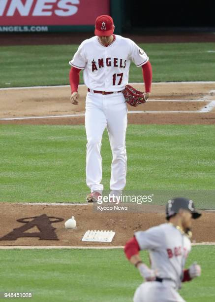 Shohei Ohtani of the Los Angeles Angels is pictured after being hit for a solo homer by Mookie Betts of the Boston Red Sox during the first inning of...