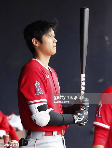 Shohei Ohtani of the Los Angeles Angels is pictured in the dugout during a spring training game against the Seattle Mariners on March 10 in Peoria...