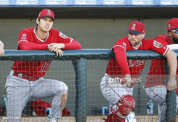 Shohei Ohtani of the Los Angeles Angels is seen in the dugout during a spring training game against the Texas Rangers in Surprise Arizona on March 18...