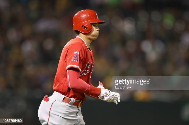 Shohei Ohtani of the Los Angeles Angels jogs to first base after being walked in the second inning against the Oakland Athletics at Oakland Alameda...