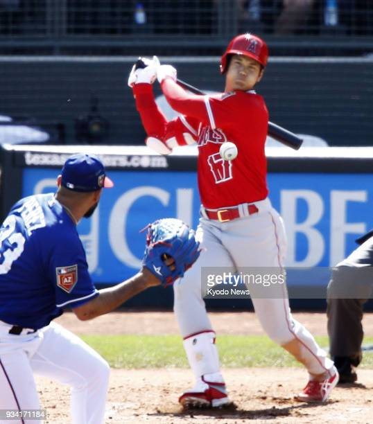 Shohei Ohtani of the Los Angeles Angels lines into a double play in the fourth inning of a spring training game against the Texas Rangers in Surprise...