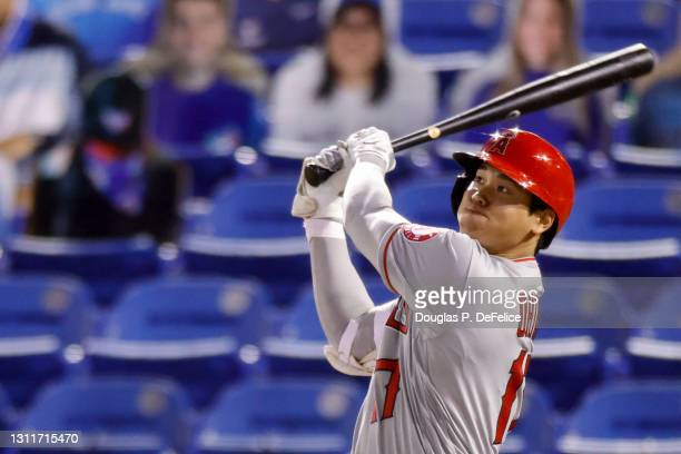 Shohei Ohtani of the Los Angeles Angels looks on after hitting a solo home run to center field during the fifth inning against the Toronto Blue Jays...