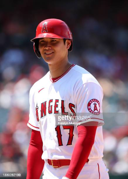 Shohei Ohtani of the Los Angeles Angels looks on from first base during the fifth inning against the Seattle Mariners at Angel Stadium of Anaheim on...