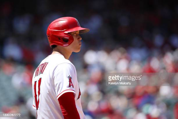 Shohei Ohtani of the Los Angeles Angels looks on from first base during the third inning against the Seattle Mariners at Angel Stadium of Anaheim on...