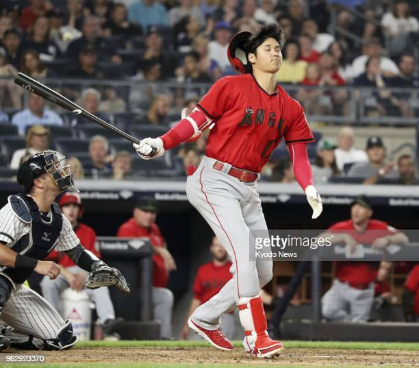 Shohei Ohtani of the Los Angeles Angels loses his helmet on a swing during the sixth inning of a game against the New York Yankees in New York on May...