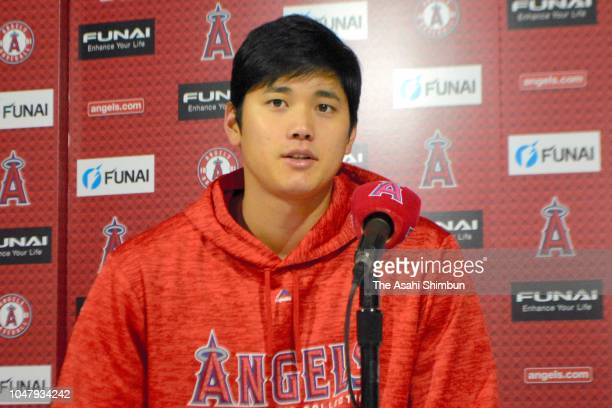 Shohei Ohtani of the Los Angeles Angels of Anaheim answers a question at a press conference prior to his team's game against the Oakland Athletics at...