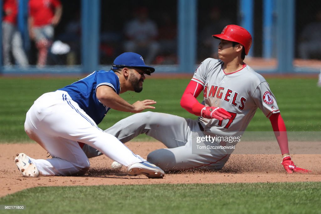 Shohei Ohtani #17 of the Los Angeles Angels of Anaheim arrives safely at second base in the eighth inning during MLB game action as Devon Travis #29 of the Toronto Blue Jays cannot handle the throw at Rogers Centre on May 24, 2018 in Toronto, Canada.