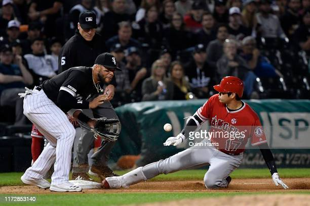 Shohei Ohtani of the Los Angeles Angels of Anaheim beats the ball to third to hit a triple in the seventh inning against the Chicago White Sox at...