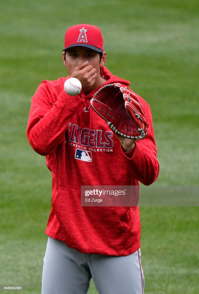 Shohei Ohtani #17 of the Los Angeles Angels of Anaheim blows into his hand as he throws the ball around prior to a game against the Kansas City Royals at Kauffman Stadium on April 14, 2018 in Kansas City, Missouri.