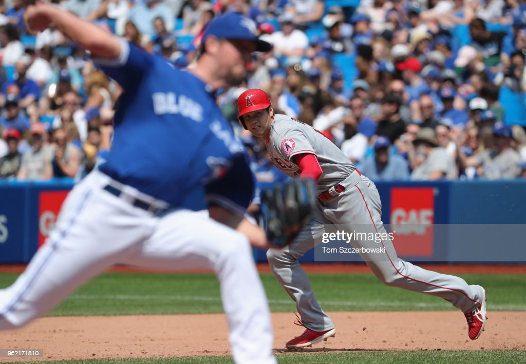 Shohei Ohtani #17 of the Los Angeles Angels of Anaheim breaks for second base as he attempts to steal a base in the eighth inning during MLB game action as Deck McGuire #48 the Toronto Blue Jays delivers a pitch at Rogers Centre on May 24, 2018 in Toronto, Canada.