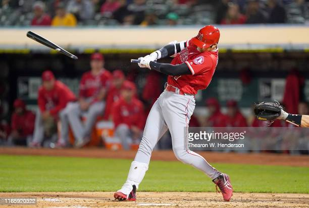 Shohei Ohtani of the Los Angeles Angels of Anaheim breaks his bat grounding into a double play against the Oakland Athletics in the top of the third...