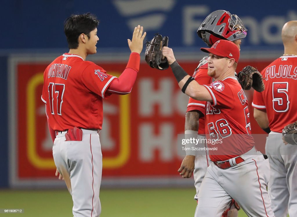 Shohei Ohtani #17 of the Los Angeles Angels of Anaheim celebrates a victory with Kole Calhoun #56 against the Toronto Blue Jays at Rogers Centre on May 23, 2018 in Toronto, Canada.