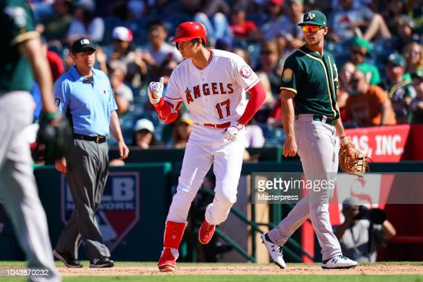 Shohei Ohtani of the Los Angeles Angels of Anaheim celebrates during the game against the Oakland Athletics at Angel Stadium on September 30 2018 in...