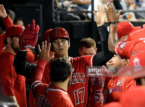 Shohei Ohtani of the Los Angeles Angels of Anaheim celebrates in the dugout with teammates after scoring in the seventh inning against the Chicago...