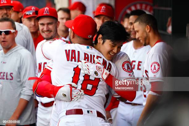 Shohei Ohtani of the Los Angeles Angels of Anaheim celebrates with Luis Valbuena after he hits a solo home run during the MLB game against the Los...