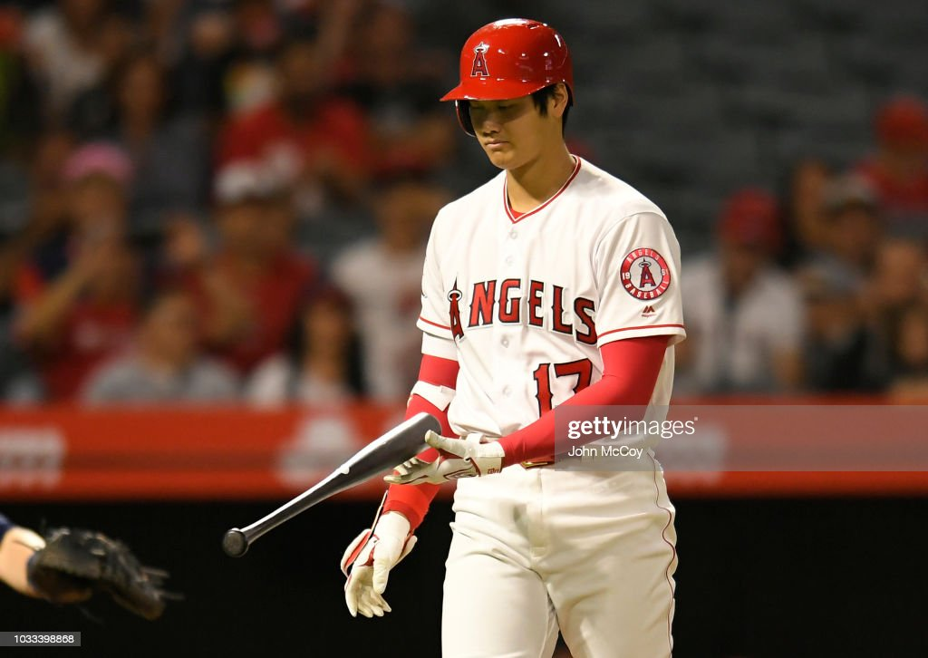 Shohei Ohtani #17 of the Los Angeles Angels of Anaheim flips his bat after hitting the ball foul in the eihth inning at Angel Stadium on September 14, 2018 in Anaheim, California.