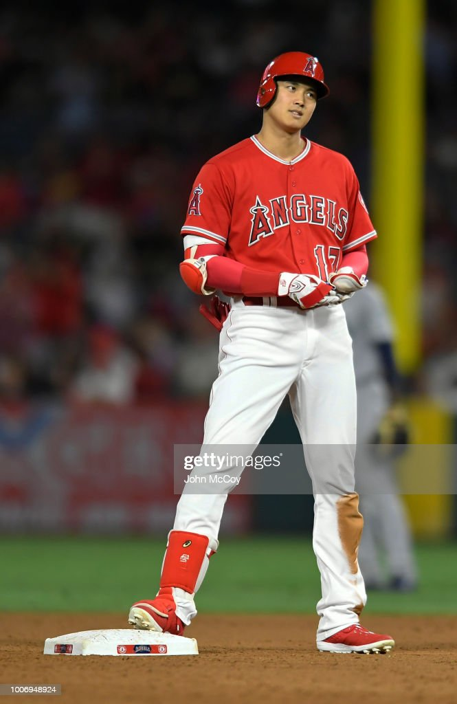 Shohei Ohtani #17 of the Los Angeles Angels of Anaheim gets a double in the eighth inning against the Seattle Mariners at Angel Stadium on July 28, 2018 in Anaheim, California.