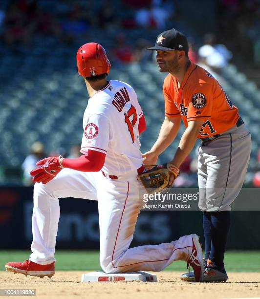 Shohei Ohtani of the Los Angeles Angels of Anaheim gets a hand from Jose Altuve of the Houston Astros as he slid into second on what turned out to be...