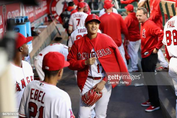 Shohei Ohtani of the Los Angeles Angels of Anaheim greets teammates prior to a game against the Boston Red Sox at Angel Stadium on April 17 2018 in...