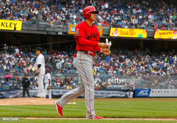 Shohei Ohtani of the Los Angeles Angels of Anaheim heads to first base after drawing a walk in the fourth inning against Masahiro Tanaka of the New...
