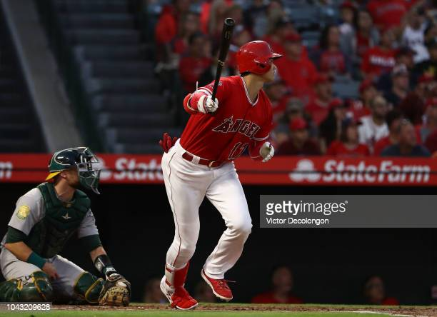 Shohei Ohtani of the Los Angeles Angels of Anaheim hits a line drive out to left field during the first inning of the MLB game against the Oakland...