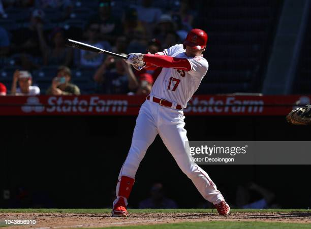 Shohei Ohtani of the Los Angeles Angels of Anaheim hits a single to center field during the ninth inning of the MLB game against the Oakland...