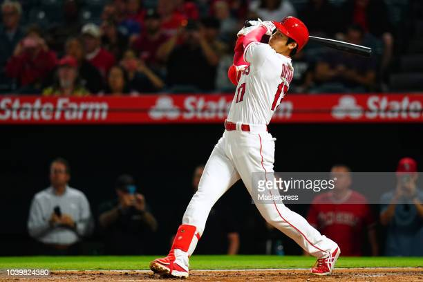 Shohei Ohtani of the Los Angeles Angels of Anaheim hits a solo home run during the game against the Texas Rangers at Angel Stadium on September 24...
