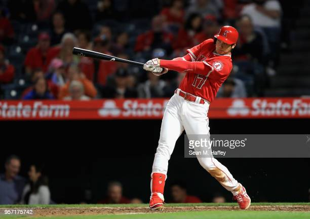 Shohei Ohtani of the Los Angeles Angels of Anaheim hits a solo homerun during the seventh inning of a game against the Minnesota Twins at Angel...