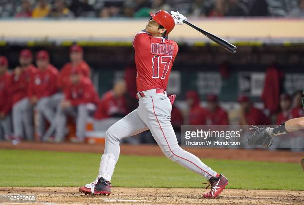Shohei Ohtani of the Los Angeles Angels of Anaheim hits an rbi double scoring David Fletcher against the Oakland Athletics in the top of the fifth...