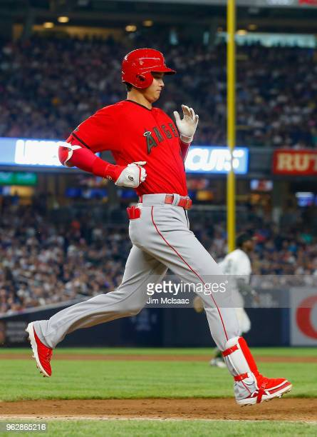 Shohei Ohtani of the Los Angeles Angels of Anaheim hits into a run scoring double play during the sixth inning against the New York Yankees at Yankee...