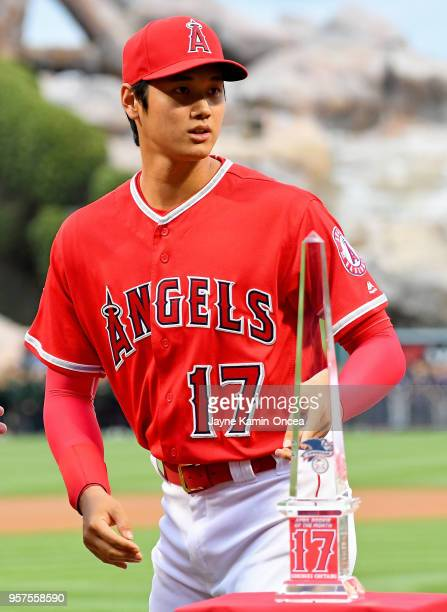 Shohei Ohtani of the Los Angeles Angels of Anaheim holds the American League Rookie of the Month award he was given before the game against the...