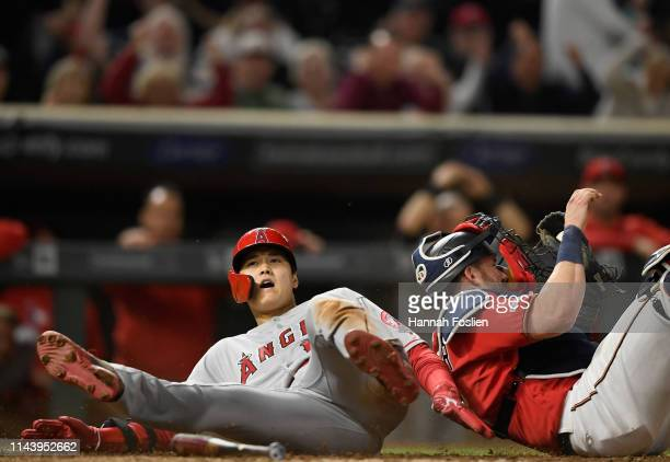 Shohei Ohtani of the Los Angeles Angels of Anaheim is out as Mitch Garver of the Minnesota Twins defends home plate during the eighth inning of the...