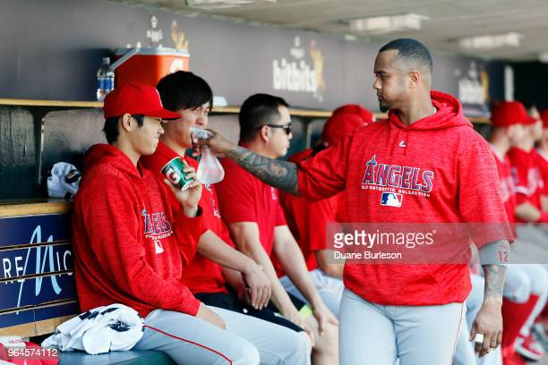 Shohei Ohtani of the Los Angeles Angels of Anaheim is sprayed with water by Martin Maldonado of the Los Angeles Angels of Anaheim to cool off during...