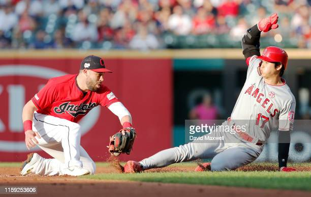 Shohei Ohtani of the Los Angeles Angels of Anaheim is tagged out at second base by Jason Kipnis of the Cleveland Indians at Progressive Field in the...