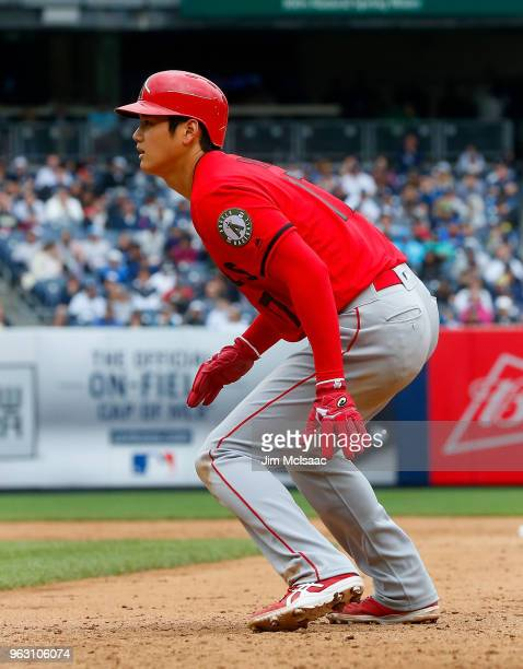 Shohei Ohtani of the Los Angeles Angels of Anaheim leads off first base during the ninth inning against the New York Yankees at Yankee Stadium on May...