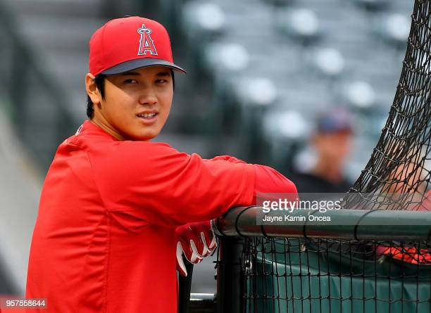Shohei Ohtani of the Los Angeles Angels of Anaheim leans on the cage during practice before the game against the Minnesota Twins at Angel Stadium on...